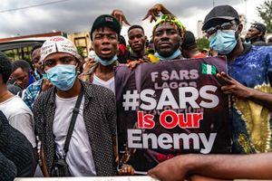 #EndSARS protestors pictured with signs reading 'SARS Is Our Enemy.'