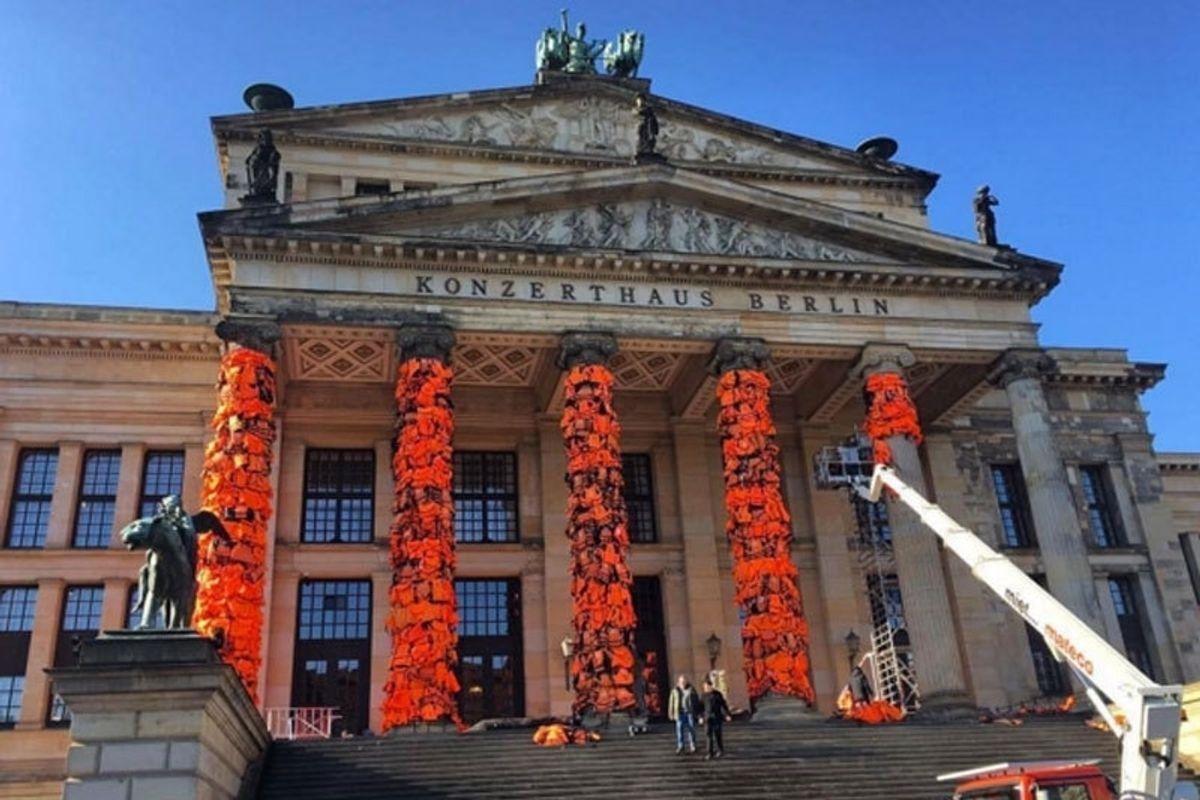 Ai Weiwei Wraps 14,000 Refugee Lifejackets Around Berlin Theater