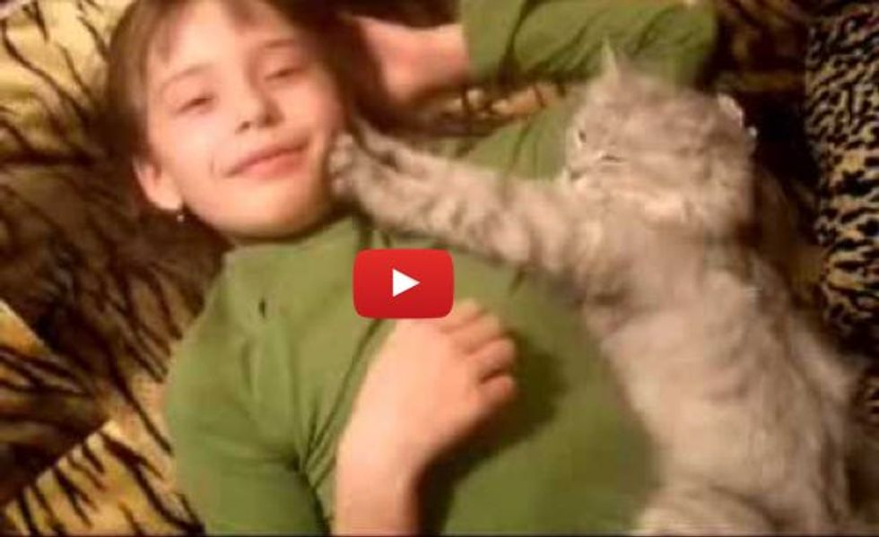 Kitty Keeps His Human's Smile Muscles Nice and Supple with His Kneady Paws!