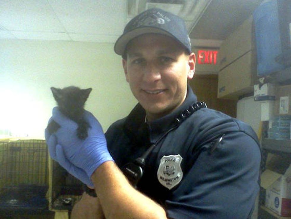 Police Officer Saves Tiny Kitten From Abandoned Home