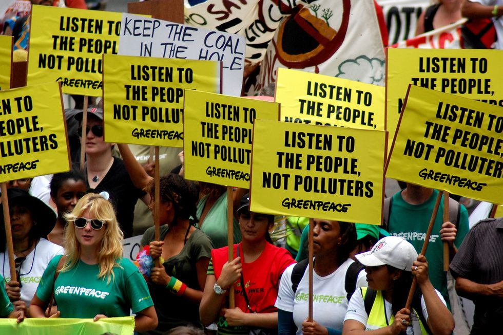 Hundreds Protest Inside U.N. Climate Talks