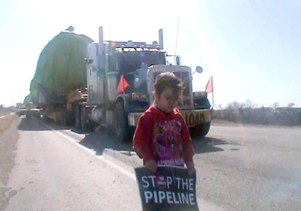 Lakota Draw a Line on the Land to Block Keystone Pipeline Trucks