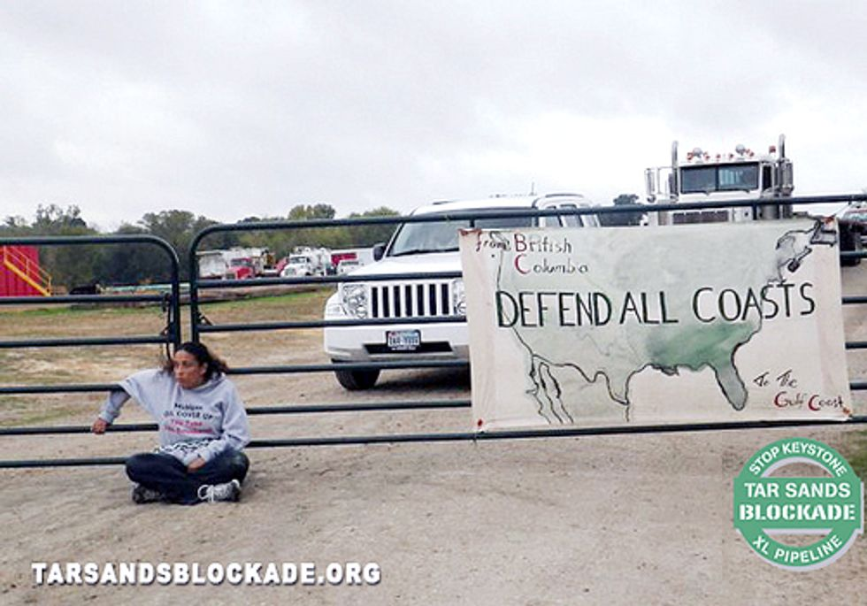 Wife of Gulf Coast Oilfield Worker Chains Herself to Keystone XL Pipeyard Gate