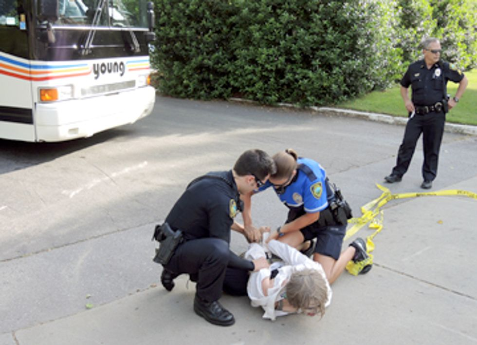 Three Arrested Blockading Bus at Genetically Engineered Tree Conference