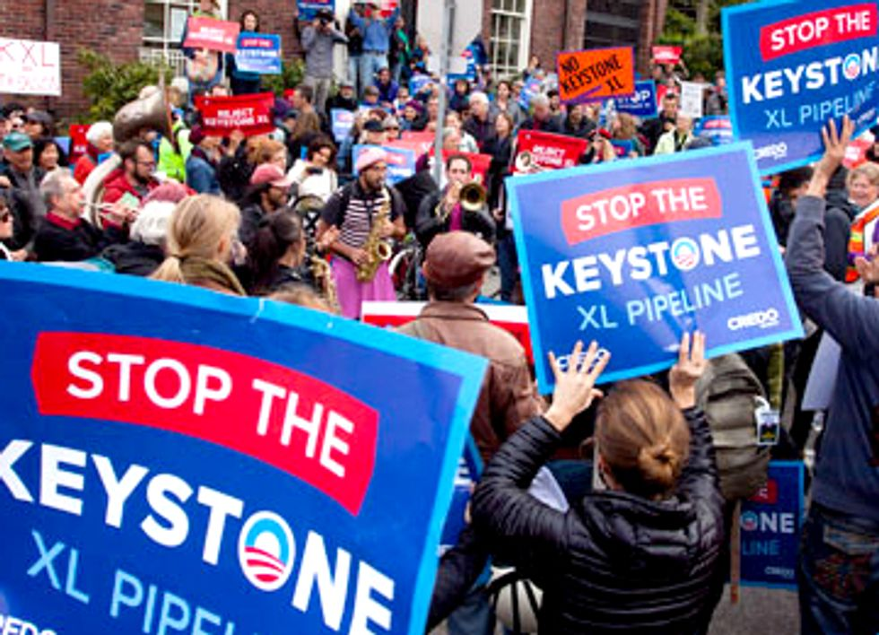 22 Arrested in Chicago Urging President Obama to Reject Keystone XL