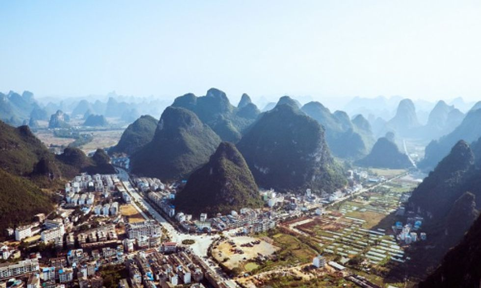 China Bulldozes Mountains to Expand Cities