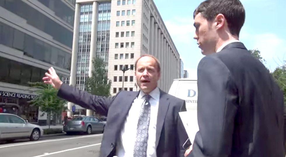 Watch a Greenpeace Activist Confront a Coal Lobbyist as He Fails to Catch a Cab