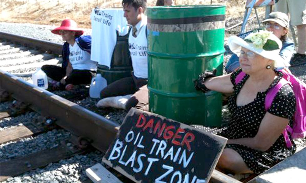 3 Arrested Blockading Train Tracks Protesting Oil-By-Rail