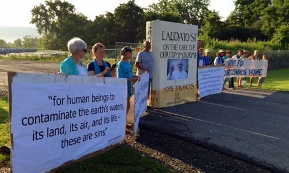 13 Arrested Blockading Crestwood Gate With Giant Replica of Pope Francis' Encyclical