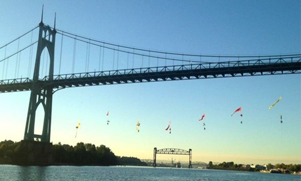 Breaking: 13 Greenpeace Activists Suspended From Bridge Block Shell Oil Vessel