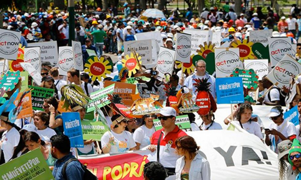 Thousands March in Lima Demanding Climate Action