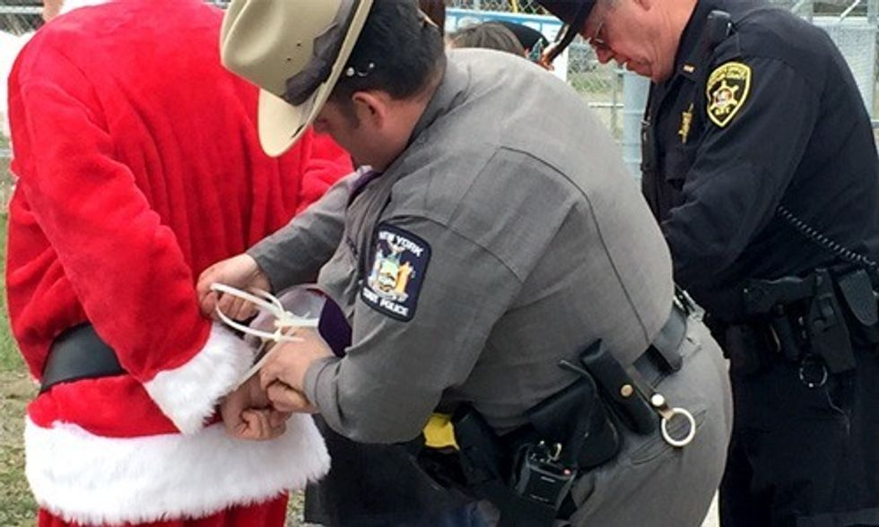 Santa Arrested at Gates of Crestwood Saying No to Dirty Energy, Yes to Renewables