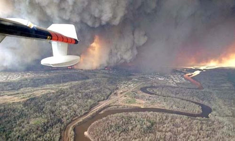 Record-Breaking Wildfire Rages On in Canada's Oil Sands Region