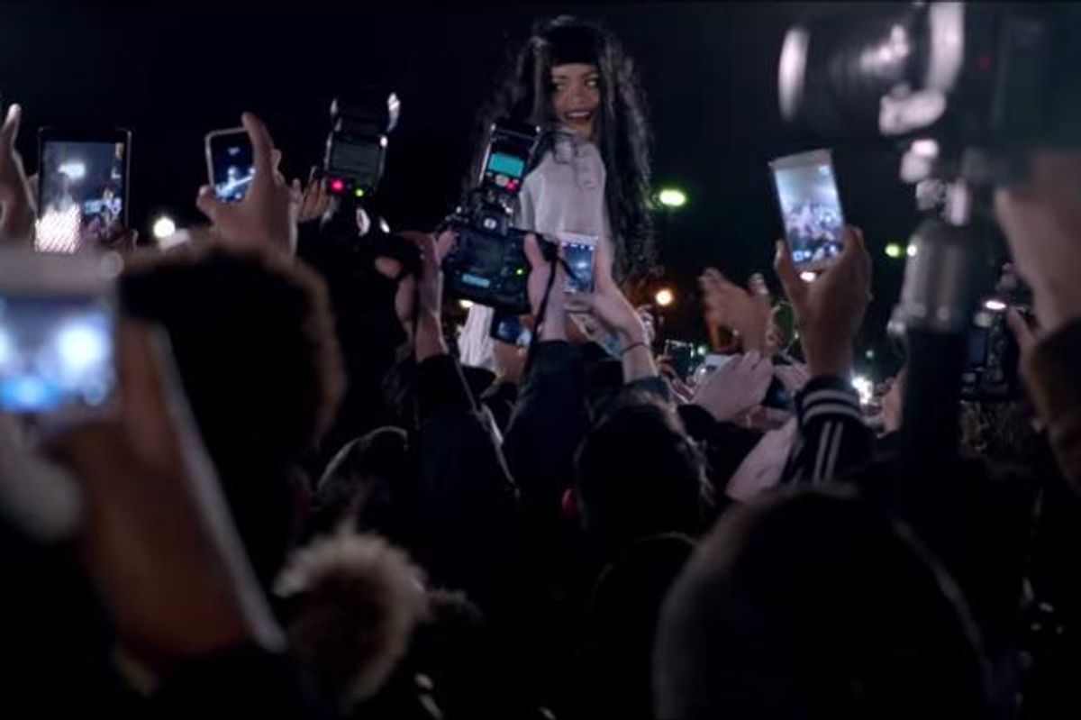 Rihanna Rushes Into A Crowd Of French Fans In The Video For 'Goodnight Gotham'