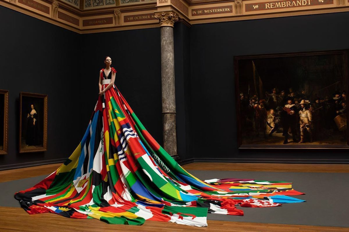Trans Model Valentijn De Hingh Poses in Dress Made from the Flags of 72 Anti-LGBTQ Countries