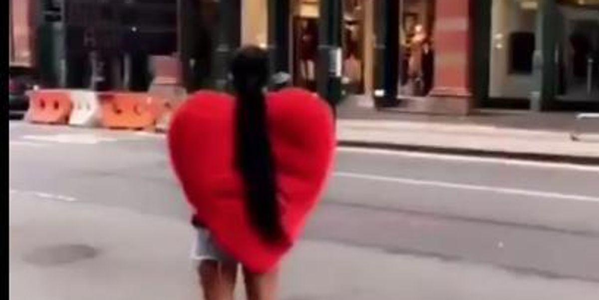 ICYMI: Rihanna Walking Around Soho At 7 AM Wearing A Giant Heart, Feeding Birds