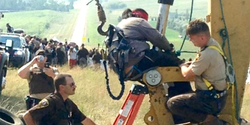 Protesters Lock Their Bodies to Machines to Stop Dakota Access Pipeline