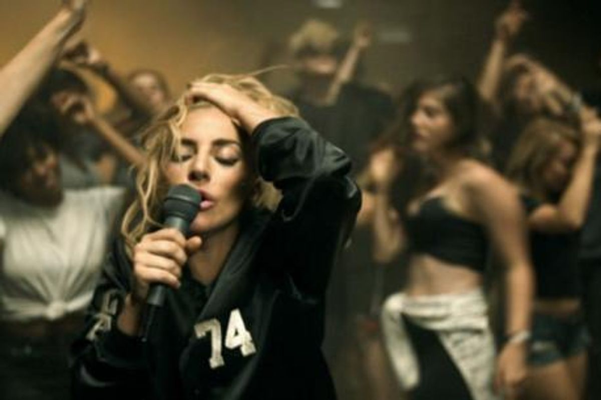 "Watch Lady Gaga's High Energy New Video For ""Perfect Illusion"""