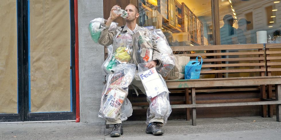 Watch This Man Walk Around NYC Wearing His Trash