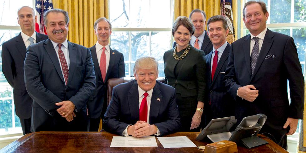 Trump Gives Pen to Dow Chemical CEO After Signing Executive Order to Eliminate Regulations