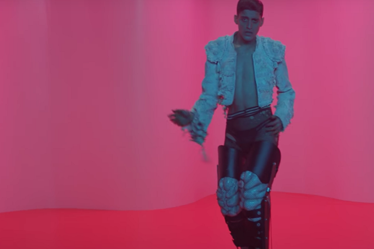 "Watch Arca Dance Around a Room While Wearing Stilts in New Video for ""Reverie"""
