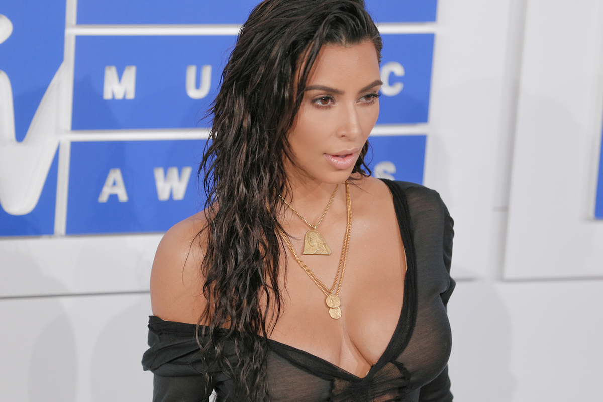 Turns Out Kanye Designed Those Medallions Kim Keeps Wearing, So You Can Buy Them Too