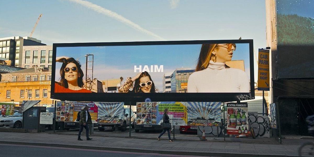Haim Tease A New Album On Billboards All Over the World