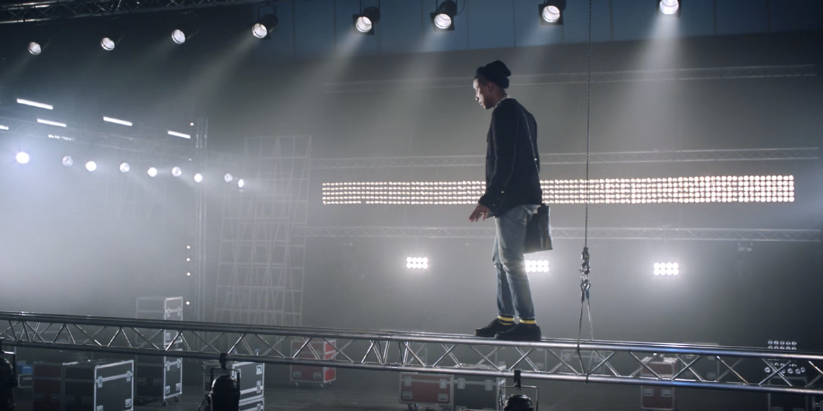 Watch Pharrell Risk His Life For a Chanel Bag