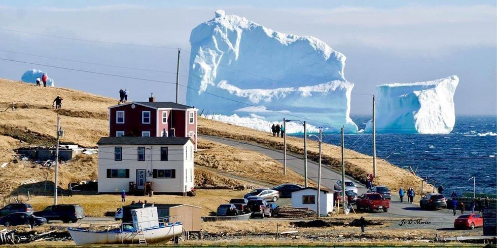Shocking Photo Shows Massive Chunk of Ice Towering Over Town