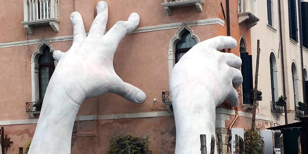 Giant Hands Rise From Venice Canal, Sends Alarming Message of Sea Level Rise