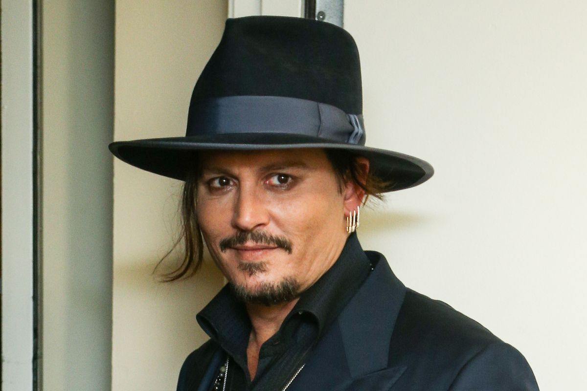 Noted Bad Decision-Maker Johnny Depp Jokes About Assassinating Trump at Glastonbury