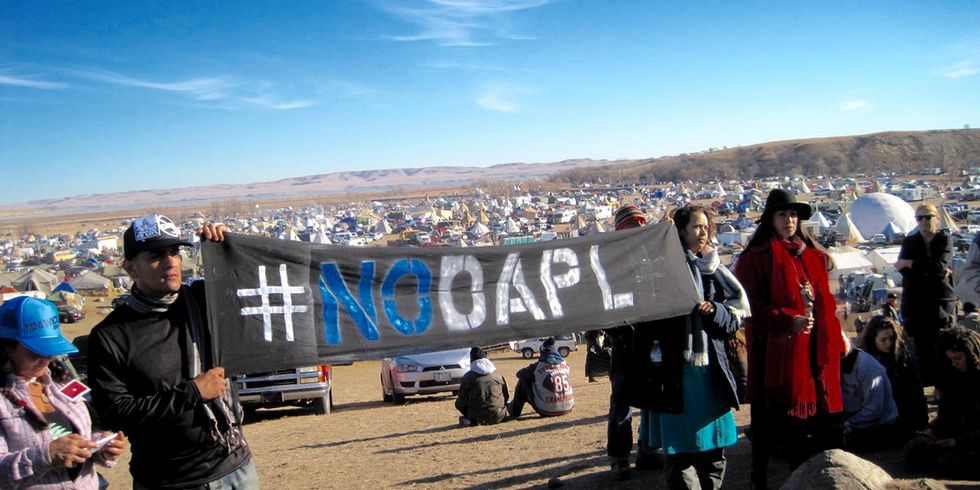 Standing Against the Banks: DAPL Divestment and Water Protectors' Fight for Justice, Indigenous Rights, Water and Life