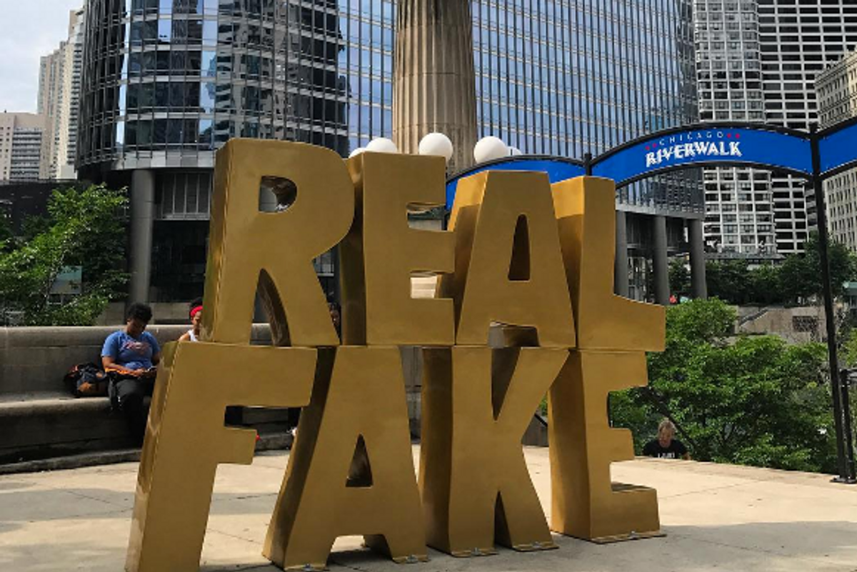 There is Now a Gold, Gleaming 'Real Fake' Statue Outside Chicago's Trump Tower