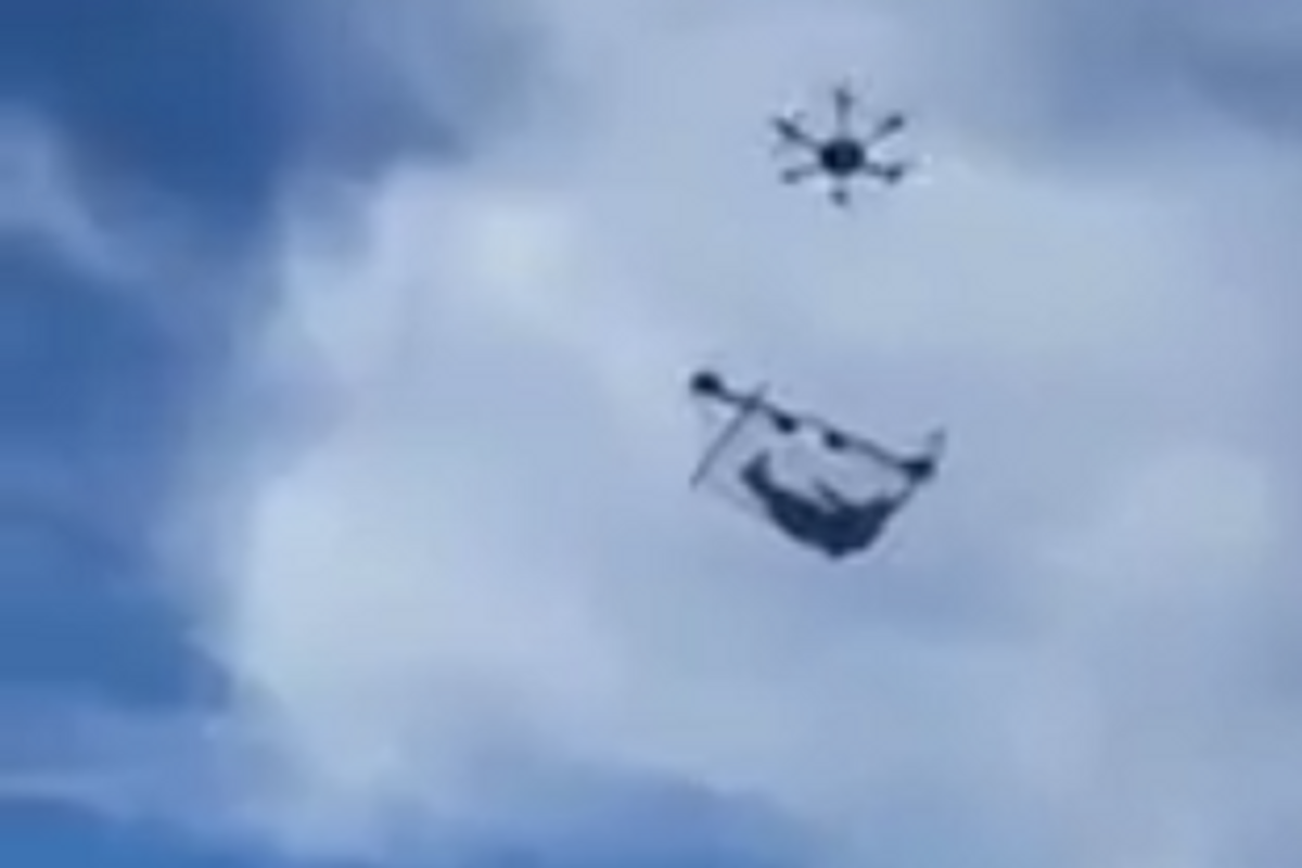 May We All Be as Carefree as This Man Flying Around Town in a Drone-Suspended Hammock