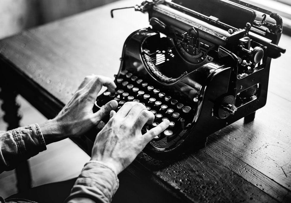 Someone typing on old typewriter