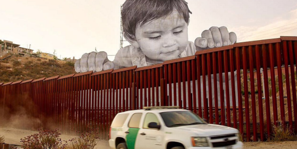 Giant Baby Mural Placed at U.S.-Mexico Border Wall