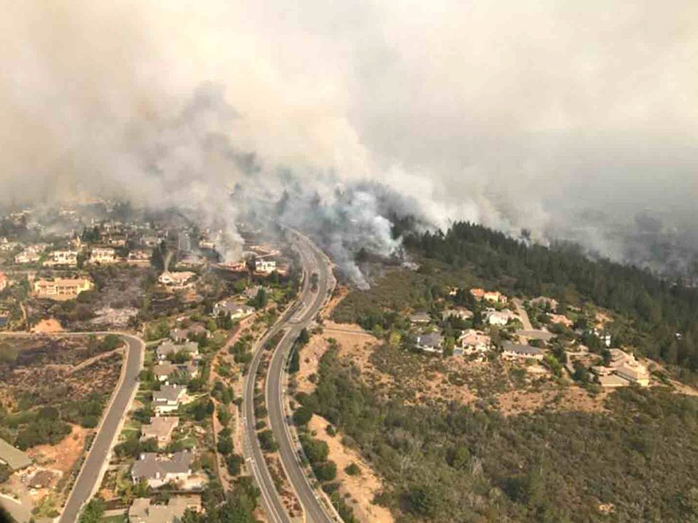 'Unprecedented' Wildfires Break Out in Northern and Southern California