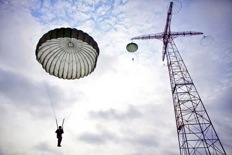 Elite airman parachuting