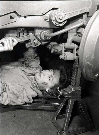 Princess Elizabeth under a car WWII