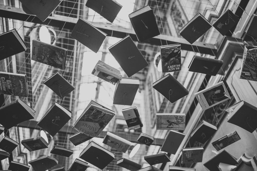 https://www.pexels.com/photo/books-sculpture-write-reading-34627/