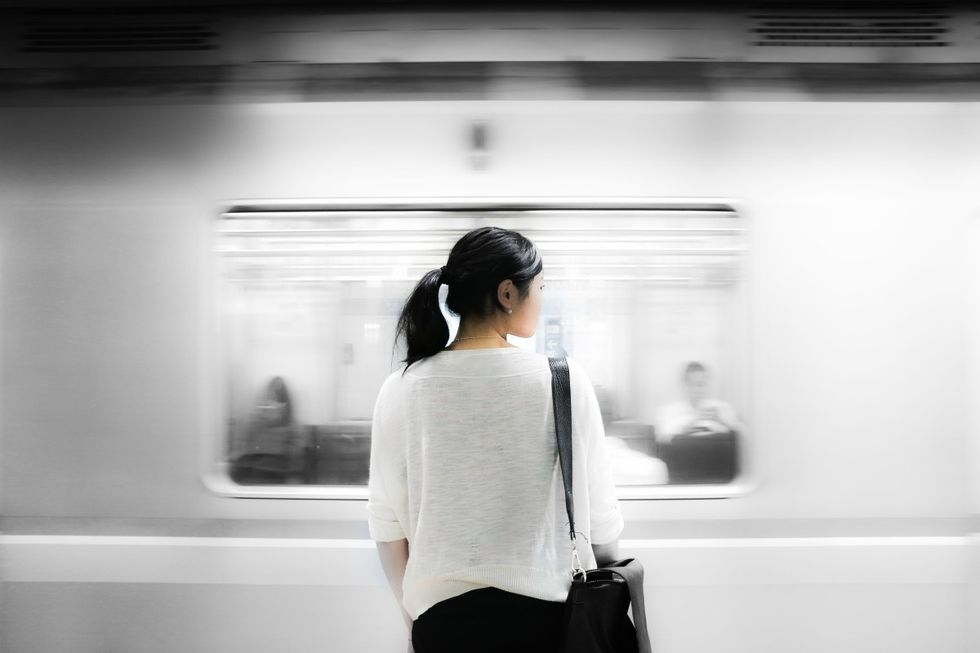 girl standing in front of a train