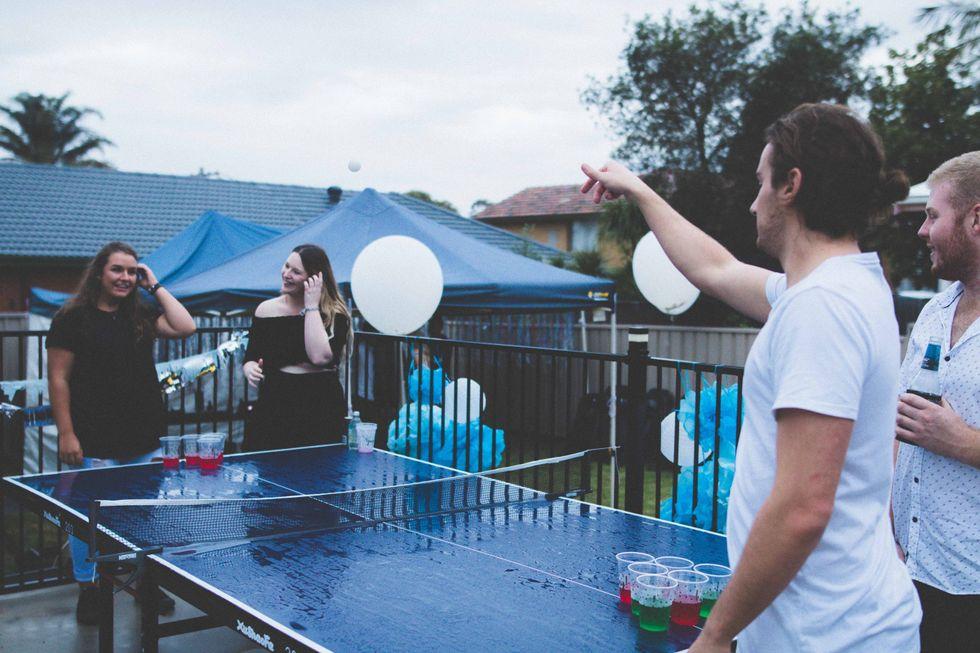 Teens playing juice pong