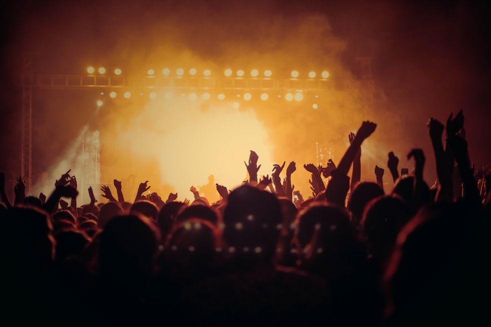 https://www.pexels.com/photo/people-at-concert-1105666/