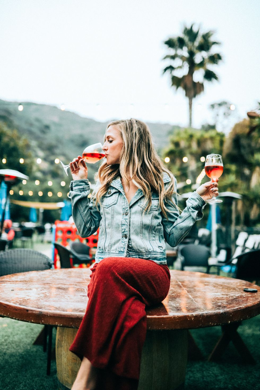 woman drinking rose