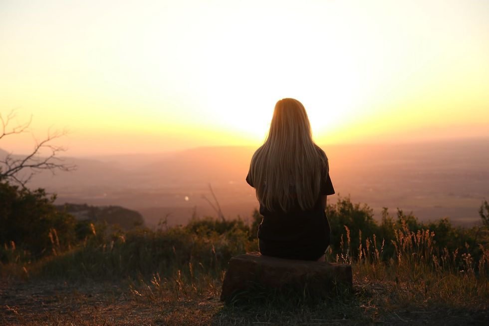 https://www.pexels.com/photo/woman-looking-at-sunset-247195/