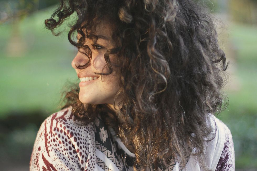 smiling curly haired woman