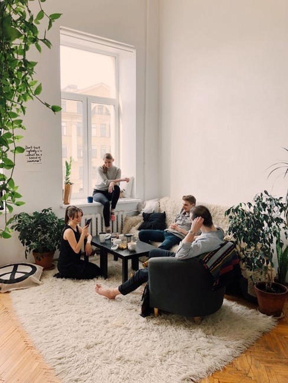 https://www.pexels.com/photo/people-gathered-inside-house-sitting-on-sofa-1054974/