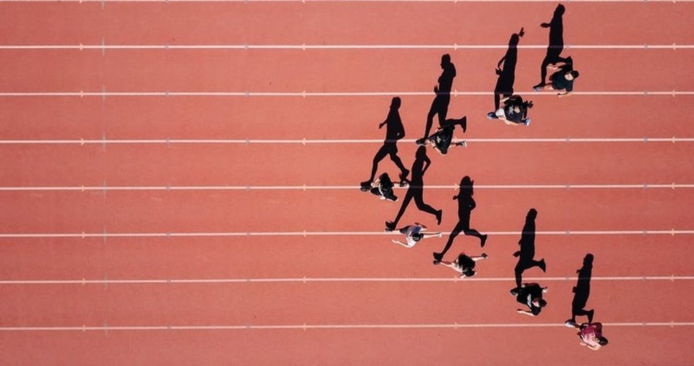 people running on track