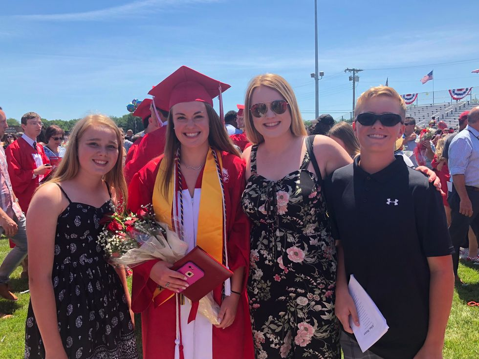 Kayla with her sisters and brother at graduation