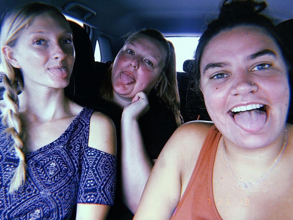 Alyssa and her 2 best friends taking a selfie in a car